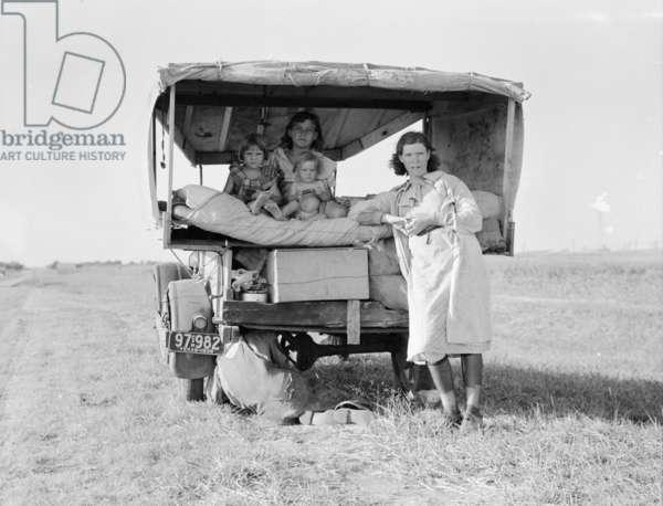 Destitute Texan family leave their home to seek work in Arkansas cotton fields, 1936 (b/w photo)