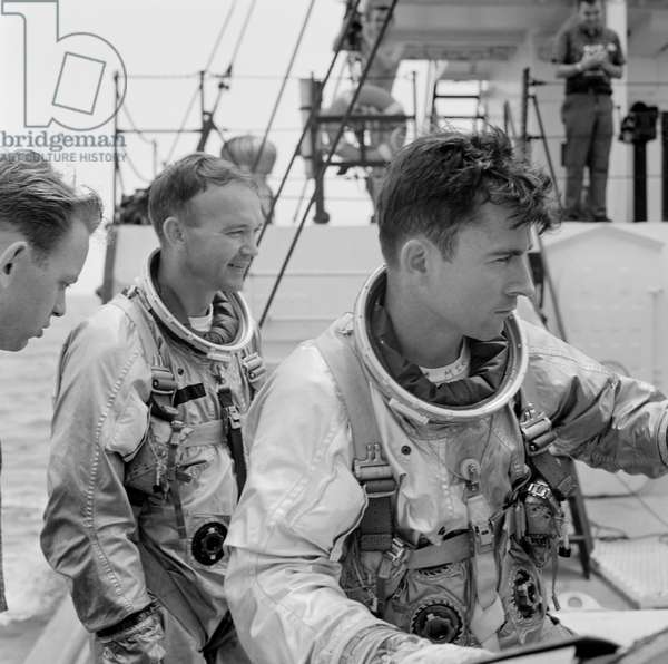 Gemini-10 prime crew members, astronaut Michael Collins (left), pilot, and John W. Young, command pilot, onboard the NASA Motor Retriever during water egress training activity, 18th June 1966 (b/w photo)