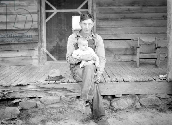 Mr. Whitfield, tobacco sharecropper, on front porch, North Carolina, 1939 (b/w photo)