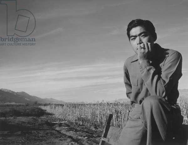 Tom Kobayashi at Manzanar Relocation Center, California, 1943 (b/w photo)