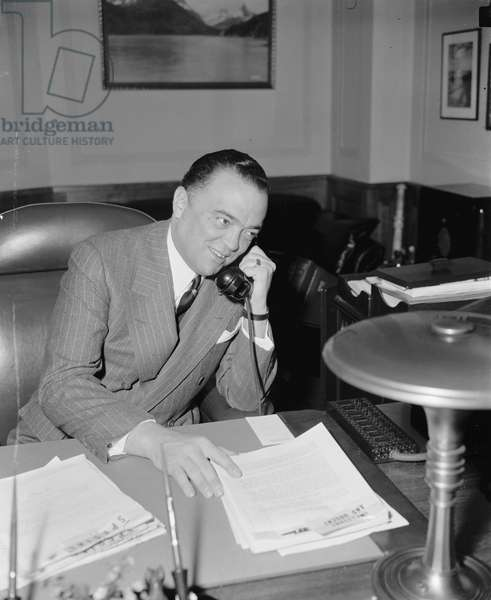 J. Edgar Hoover, Director of FBI, Department of Justice, Portrait on Telephone, Washington DC, USA, April 1940 (b/w photo)