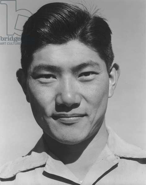 Harry (Henry) Hanawa, mechanic, Manzanar Japanese American Internment Camp, Ansel Adams, 1943 (b/w photo)