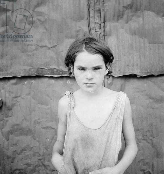 Child living in Oklahoma City shacktown, 1936 (b/w photo)