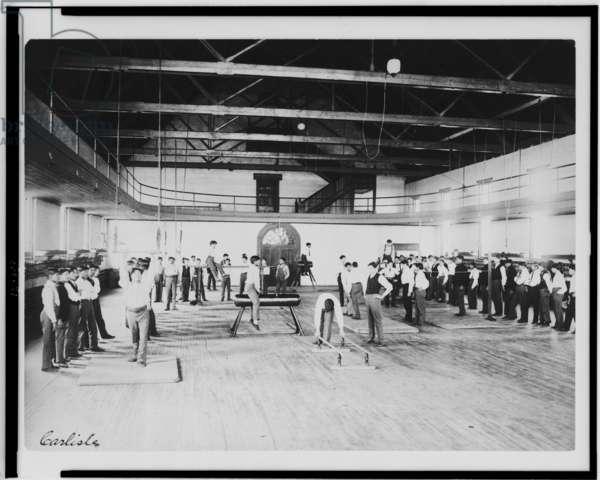 Male Native American students in physical education class, Carlisle Indian School, Pennsylvania, c.1901-03 (b/w photo)