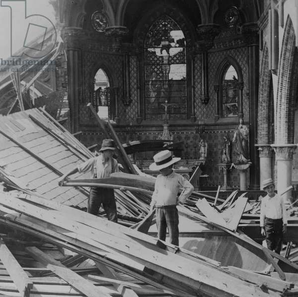 Interior of St. Patrick's Catholic church after the hurricane, 1900 (b/w photo)