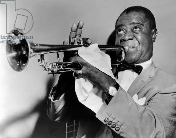 Louis Armstrong playing the trumpet, 1953 (b/w photo)