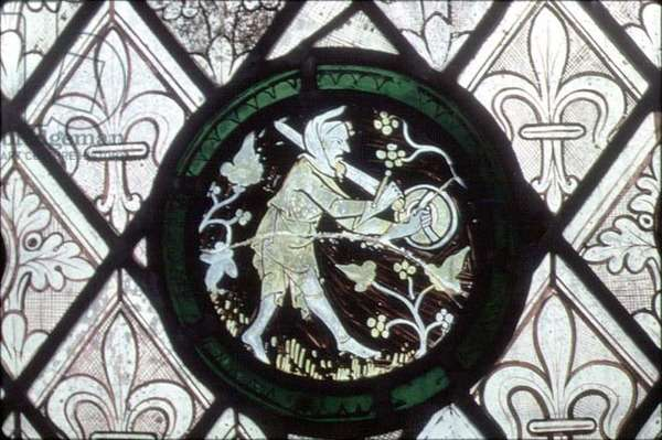 Man scaring away the birds (stained glass)