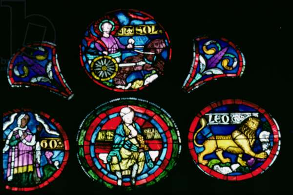 Stained Glass Rose Window depicting an Imago Mundi, detail of Fire, the Zodiac Sign of Leo and the Sun in a Chariot
