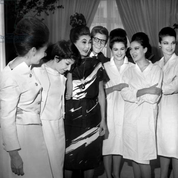 Yves Saint Laurent With Zizi Jeanmaire, Victoire and his Models After Presentation of his Winter Collection July 30, 1962, Paris (b/w photo)