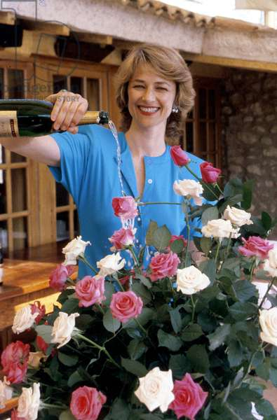 Charlotte Rampling at The Museum Castle of Cagnes Sur Mer Pourring Champagne on Roses April 27 1987 (photo)