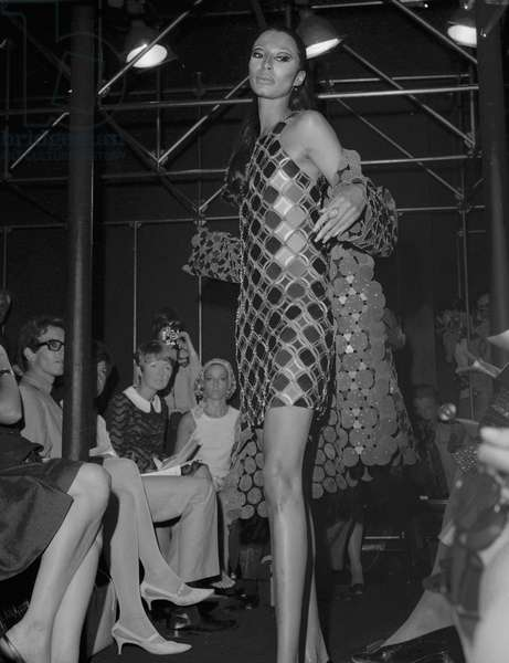Presentation of Paco Rabanne's 1967-1968 winter collection : leather and rhodoid dress and coat on July 27, 1967