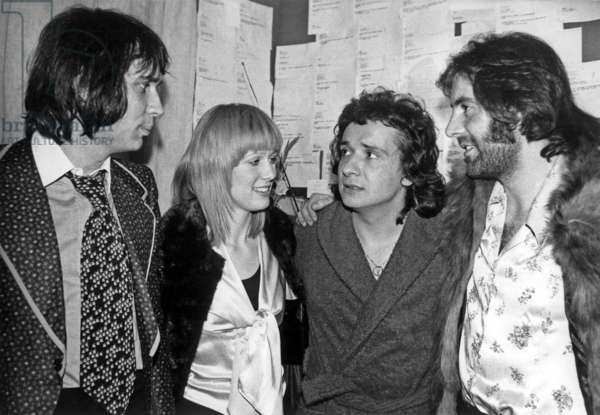 Eric Charden Stone and Michel Delpech congratulating Michel Sardou in his dressing room at the Olympia, Paris, January 18th 1973 (b/w photo)