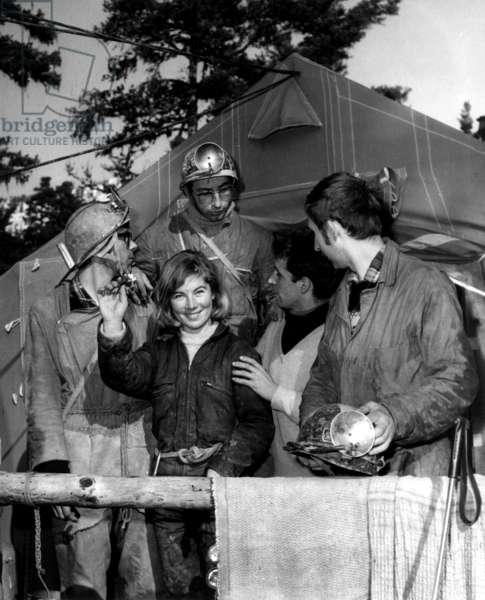 Helene Brobecker Surge From the Gouffre After One Month At 80M Underground And Three Other Speleonautes Descend From Left to Right Gerard Cappa, Philippe Englander, Michel Siffre And Jacques Chabert Surrounding Helene Brobecker March 7, 1969 (b/w photo)