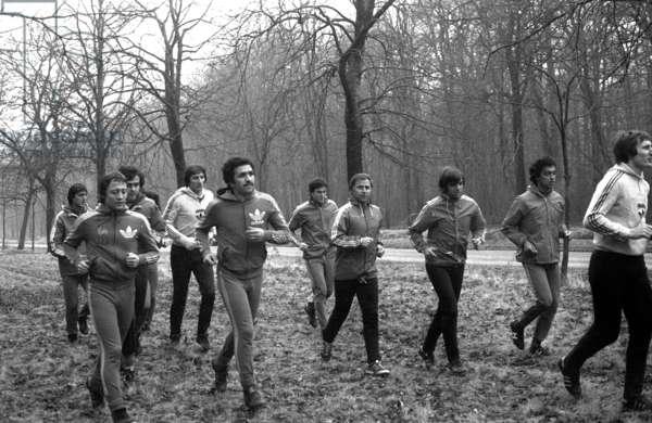 French Soccers Traingin in Forest, February 6, 1979 : Around Michel Hidalgo, Bernard Lacombe, Michel Platini, Andre Rey, Omar Sahnoun, Patrick Battiston, Albert Gemmrich and Alain Moizan (b/w photo)