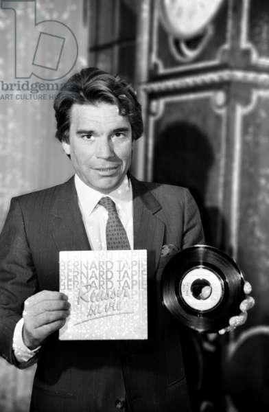 "Bernard Tapie Presenting his Future TV Programme ""Ambitions"" and Disc ""Reussir Sa Vie"" January 7, 1986 (b/w photo)"