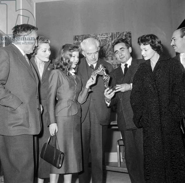 French director Henri Georges Clouzot has received the best director prize given by a Spanish jury, at UniFrance Films in Paris, February 3, 1955 : Charles Vanel, Simone Renant, Cecile Aubry, Marquis de Casa Roja (Spanish ambassador), Henri Georges Clouzot et Francoise Arnoul (b/w photo)
