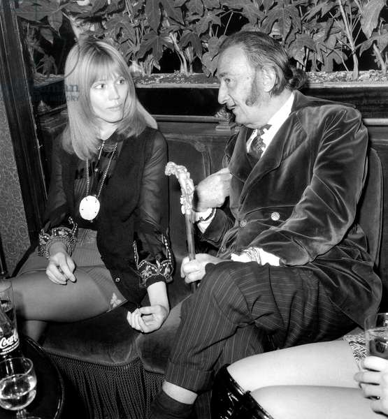 Amanda Lear and Salvador Dali on December 29, 1969 at Maxim'S Restaurant in Paris (b/w photo)