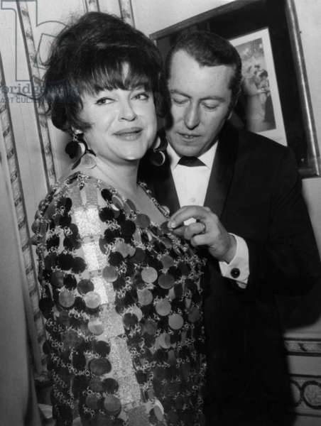 French Painter Bernard Buffet and Regine during A Party at Maxim'S Restaurant in Paris on February 4, 1967, Regine Is Wearing A Metal Dress By Paco Rabanne (b/w photo)