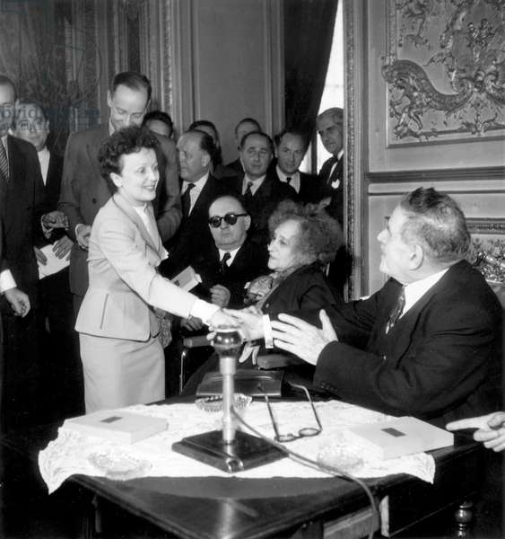 Edith Piaf Receiving Prize Given By Academy of French Disc With Writer Colette (Sidonie Gabrielle) and Edouard Herriot June 11, 1952 (b/w photo)