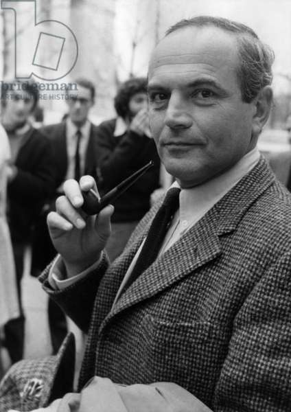 """Michel Deon received the Interrallie Prize for his novel """"Les Ponies Sauvages"""", here arriving at the Parisian Restaurant Lasserre for the Proclamation of the Results of the Jury's Vote on December 7, 1970 (b/w photo)"""