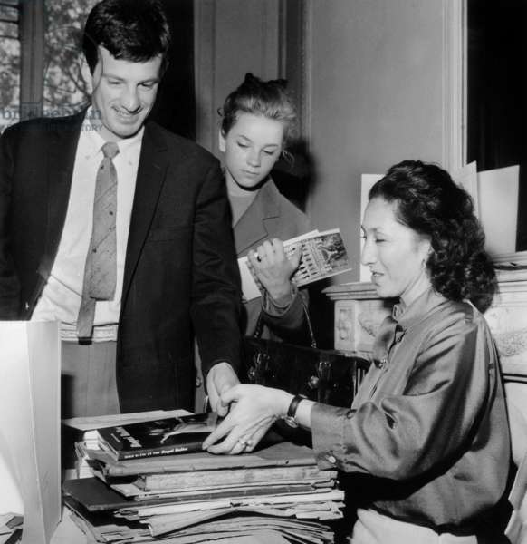 Jean Paul Belmondo and his Sister Dancer Muriel Belmondo Buying Book About Dance To Nina Vyroubova in Support of Olga Probrajenskaya (To Raise Funds For her Disease) May 06, 1962 (b/w photo)