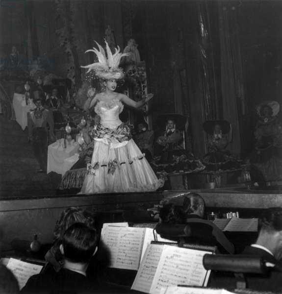 """Josephine Baker during his Show """"Feeries Et Folies"""" in Folies Bergeres in Paris on February 26, 1949 (b/w photo)"""