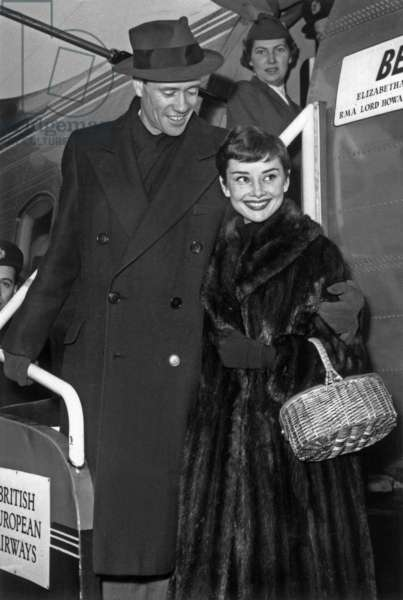 Mel Ferrer and Audrey Hepburn Arriving at Bourget Airport, Paris, February 21, 1955 (b/w photo)
