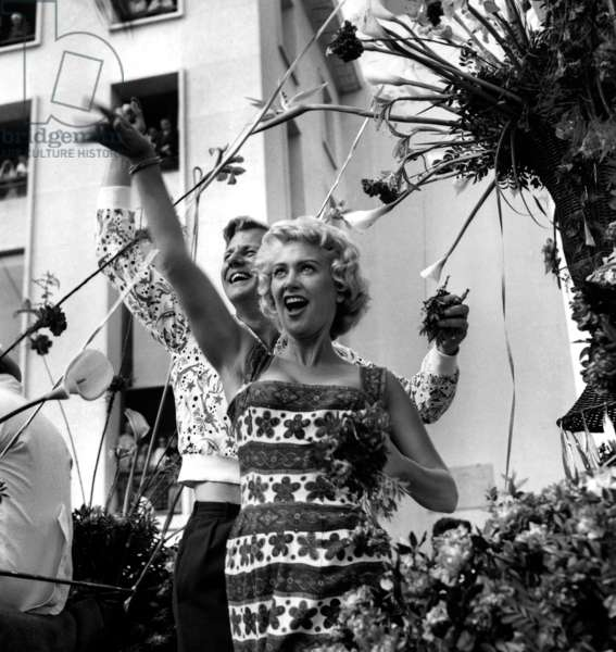 Actors Martine Carol and Tony Wright during Flowers Battle at Cannes Film Festival May 4, 1956 (b/w photo)
