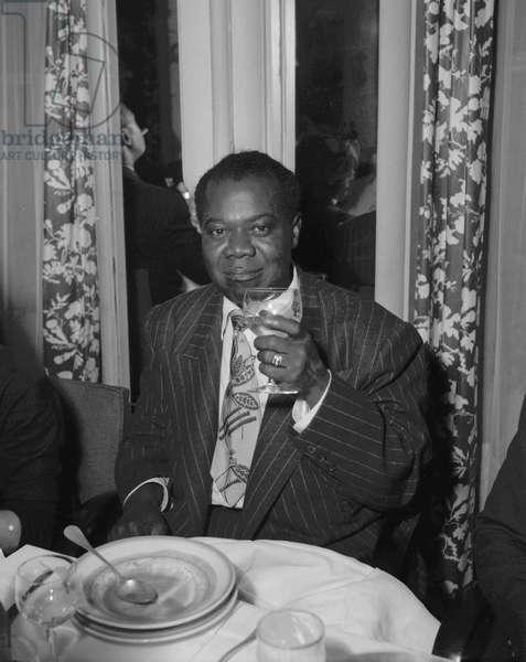 "Louis Armstrong, at the restaurant ""Mouton de Panurge"", paris, November 6, 1949 (b/w photo)"