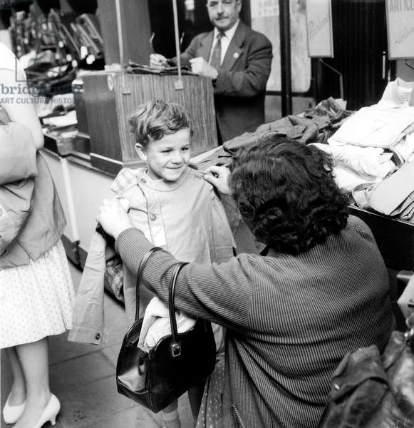 Start of School Year in France on September 11, 1958 : Buying of Apron (b/w photo)