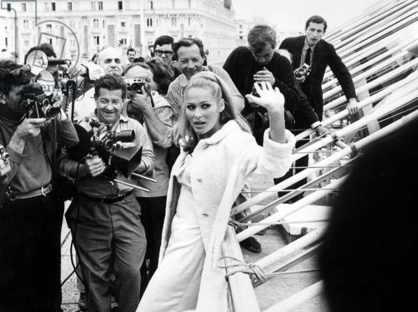 Ursula Andress surrounded By Photographers at Cannes Film Festival in 1965 (b/w photo)