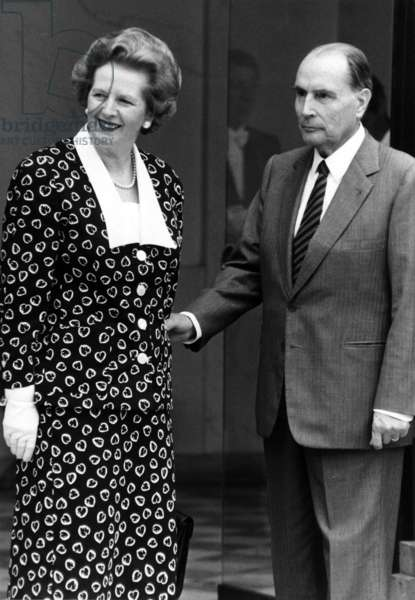 English Prime Minister Margaret Thatcher in Paris For The Treaty of The Channel Tunnel, here at Elysee Palace Greeted By French President Francois Mitterrand July 29, 1987 (b/w photo)