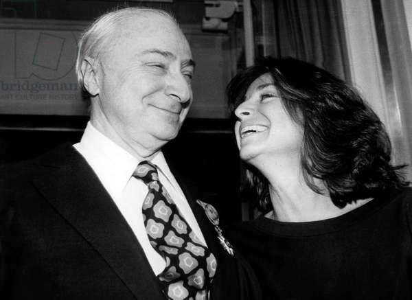 Film Director Gerard Oury Receiving Legion of Honour here Congratulated By his Daughter Danielle Thompson March 6, 1985, Paris (b/w photo)