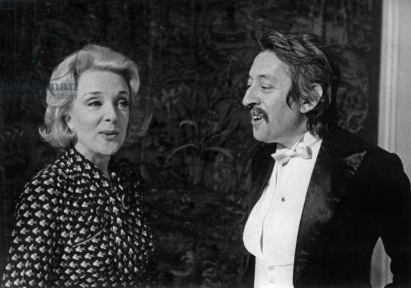 "Micheline Presle and Serge Gainsbourg on Set of Film ""Lever De Rideau"" March 2, 1973 (b/w photo)"
