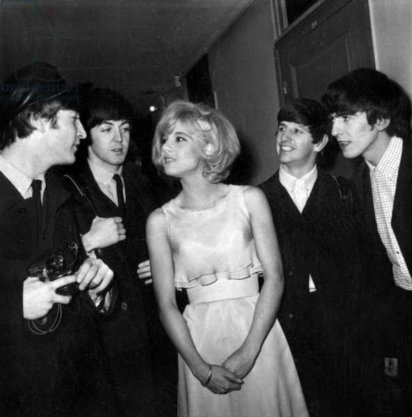 French Singer Sylvie Vartan with the Beatles ( John Lennon, Paul McCartney, Ringo Starr and George Harrison) at Olympia, Paris, January 16th 1964 (b/w photo)