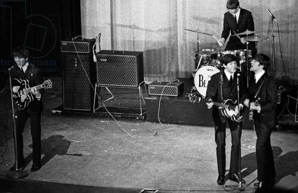 The Beatles on Stage at The Olympia in Paris on January 17, 1964 : George Harrison, Paul Mccartney and John Lennon, Behind : Ringo Starr (b/w photo)