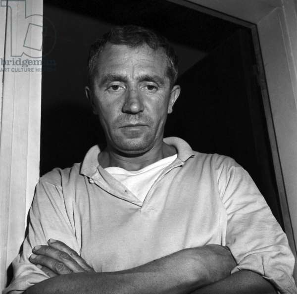 Andre Berthaud, after his arrest, on the premises of the Surete on the Rue des Saussaies, pretending not to realize the gravity of his kidnapping of little Nadine Plantagenest on October 4, 1961 (b/w photo)