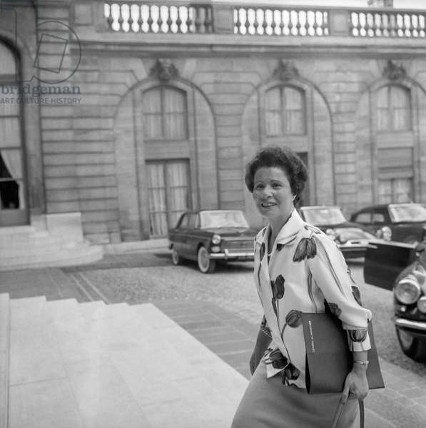 French politician Nafissa Sid Cara, arriving at the Elysee, Paris, to attend the council of ministers, August 24, 1960 (b/w photo)