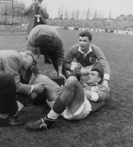 The French Rugby Player Domec Is Wounded during The Final of Rugby, of The Five Nations Tournament Between France and Wales, Winner 16 To 11, in The Stadium of Colombes, on March 26Th, 1955  (b/w photo)