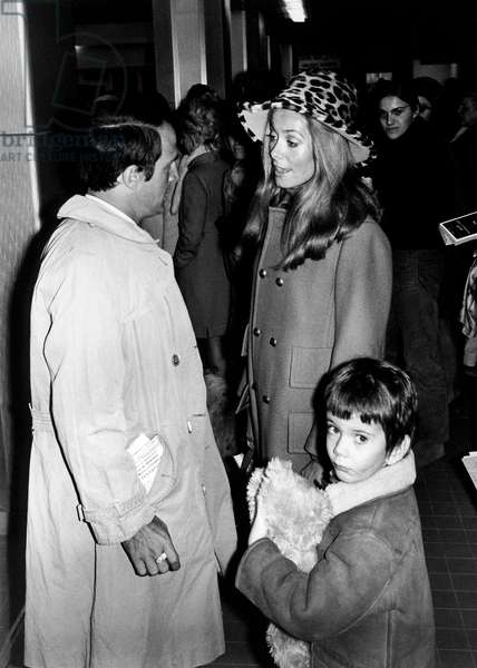 French Actress Catherine Deneuve With her Son Christian Vadim at Nice Cote D'Azur Airport Welcome By Director Francois Truffaut December 30, 1968 (b/w photo)