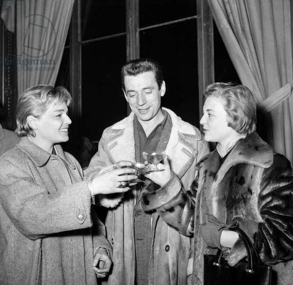 "Simone Signoret, Yves Montand, Nicole Courcel after the last rehearsal of play ""The Crucible"" at the Theatre Sarah-Bernhardt in Paris on December 14, 1954 (b/w photo)"