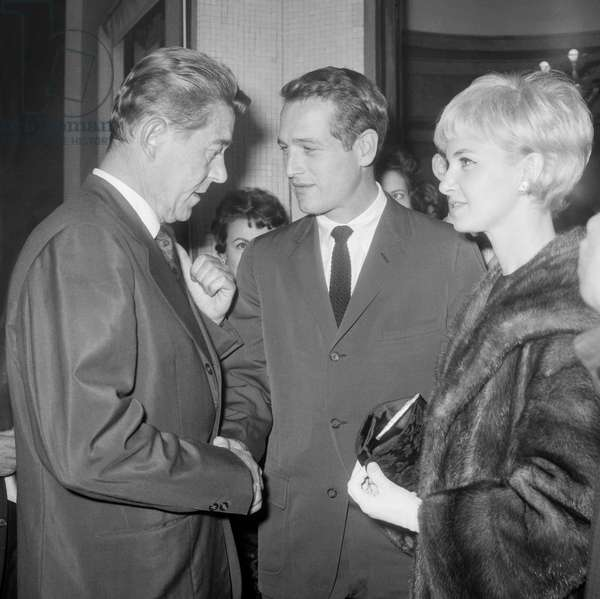 Paul Newman and his wife Joanne Woodward arriving at a reception given for us on the Champs Elysees, Paris, October 13, 1960 : on l : Jules Dassin (b/w photo)