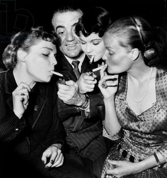 Simone Signoret, Raymond Cordy, Francoise Arnoul and Madeleine Sologne at The Annual Film Technical Staff Gala March 12, 1950 (b/w photo)