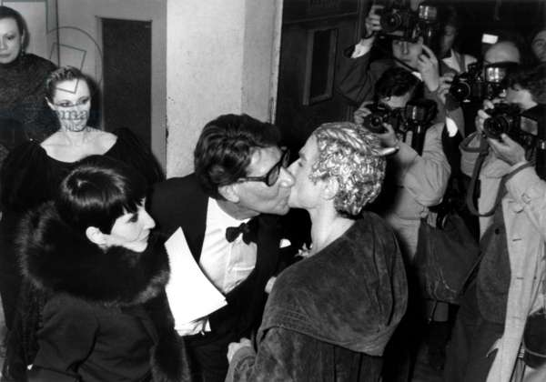 Yves Saint Laurent Kissing Rudolph Noureev during Party at Opera Comique on February 23, 1981 in Presence of Zizi Jeanmaire (L) and Douce Francois (b/w photo)