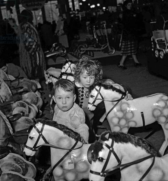 Children looking at toys, Paris, December 14, 1949 (Christmas) (b/w photo)