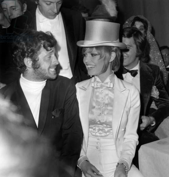 Jean Paul Belmondo and Brigitte Bardot President of The Artists Union Night, here Durig Intermission , in The Background her Friend Patrick Gille April 18, 1970 (b/w photo)