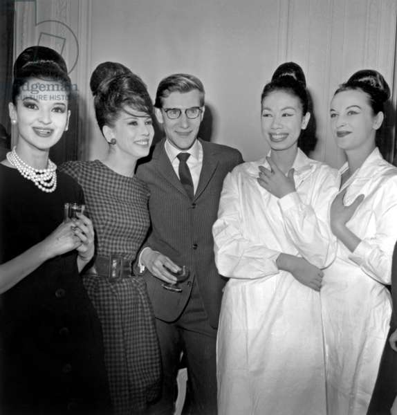 Yves Saint Laurent Congratulated By his Models After Prsentation of New Dior Fashion : L-R : Kouka, Victoire (Victoire Doutreleau), Yves Saint-Laurent on January 27, 1960 (b/w photo)