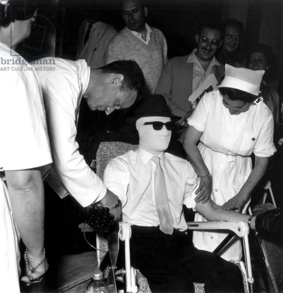 Cannes Film Festival : Invisible Man (Tima Turner) Do A Blood Donation For The Red Cross, May 18, 1963 (b/w photo)