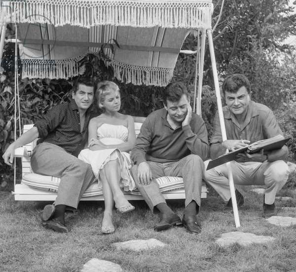 Daniel Gelin, Genevieve Cluny, Francois Perier (swing chair) and director Claude Magnier on set of film