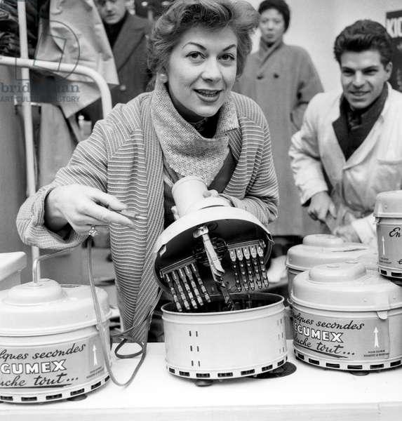 Ideal Home Fair in Paris on February 23, 1956 (b/w photo)